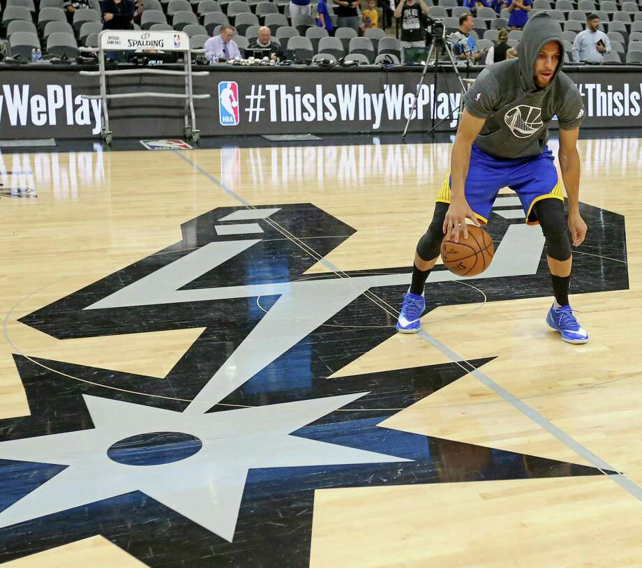 Golden State Warriors' Stephen Curry dribbles before the game with the San Antonio Spurs Wednesday March 29, 2017 at the AT&T Center. Photo: Edward A. Ornelas, Staff / San Antonio Express-News / © 2017 San Antonio Express-News