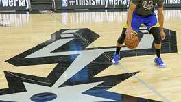 Golden State Warriors' Stephen Curry dribbles before the game with the San Antonio Spurs Wednesday March 29, 2017 at the AT&T Center.