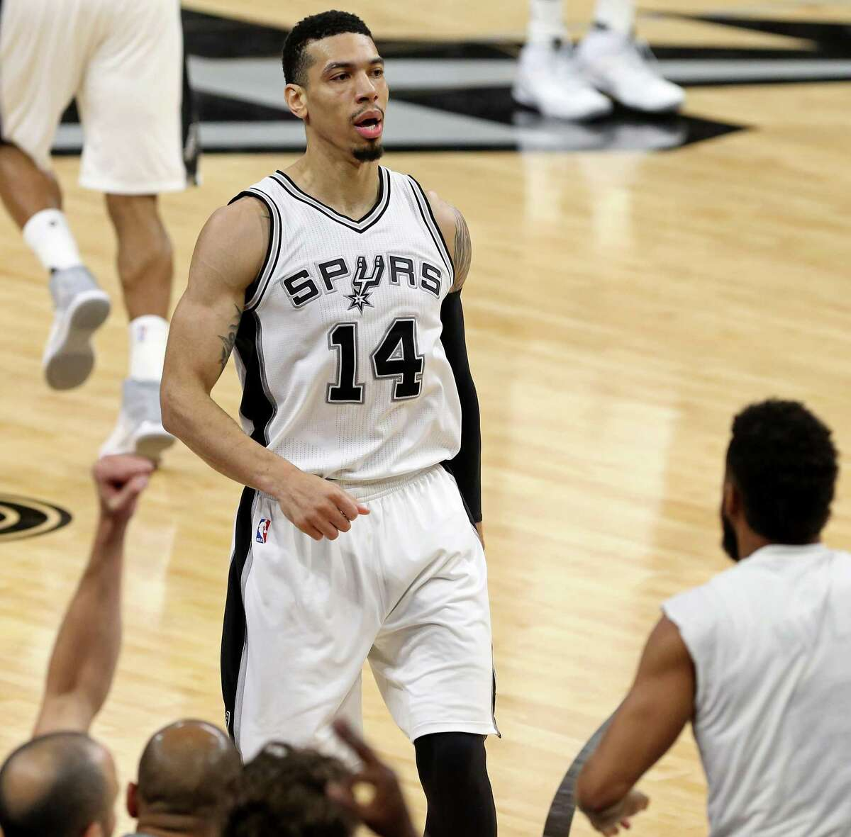 San Antonio Spurs' Danny Green reacts after making a 3-pointer during first half action against the Golden State Warriors Wednesday March 29, 2017 at the AT&T Center.