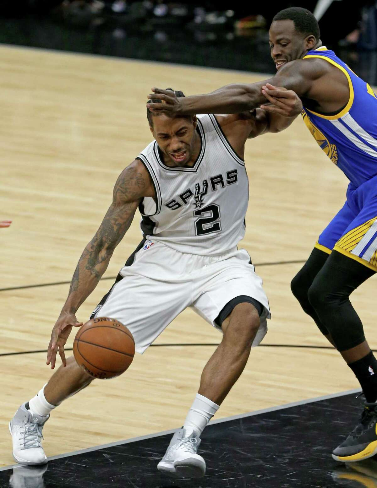 San Antonio Spurs' Kawhi Leonard looks for room around Golden State Warriors' Draymond Green during first half action Wednesday March 29, 2017 at the AT&T Center.