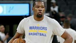 Golden State Warriors' Kevin Durant pauses before the game with the San Antonio Spurs Wednesday March 29, 2017 at the AT&T Center.