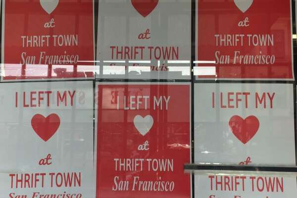 Signs posted in Thrift Town's windows on March 29. 