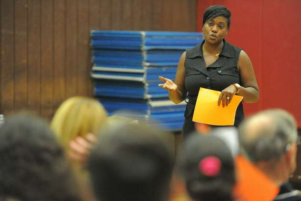 FILE — Edith Presley, principal of Julia A. Stark School, speaks about the school's D.E.A.R. (Drop Everything and Readaloud) program during the quarterly Glenbrook Neighborhood Association meeting at the Glenbrook Community Center in Stamford, Conn. on Wednesday, Sept. 21, 2016.