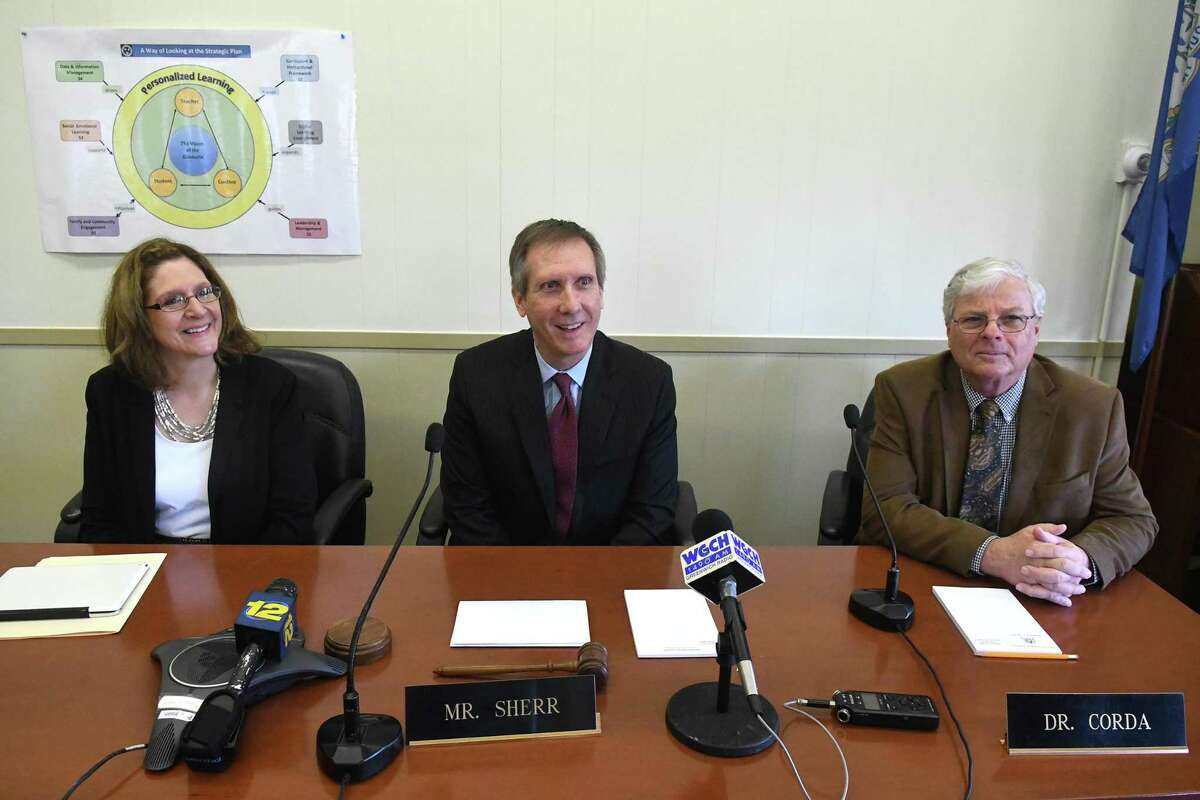 The Greenwich Board of Education Chairman Peter Sherr, center, and interim superintendent Sal Corda introduce Jill Gildea, the newly appointed Superintendent of Schools, during a Special Meeting at the Havemeyer Building in Greenwich, Conn., March 30, 2017.