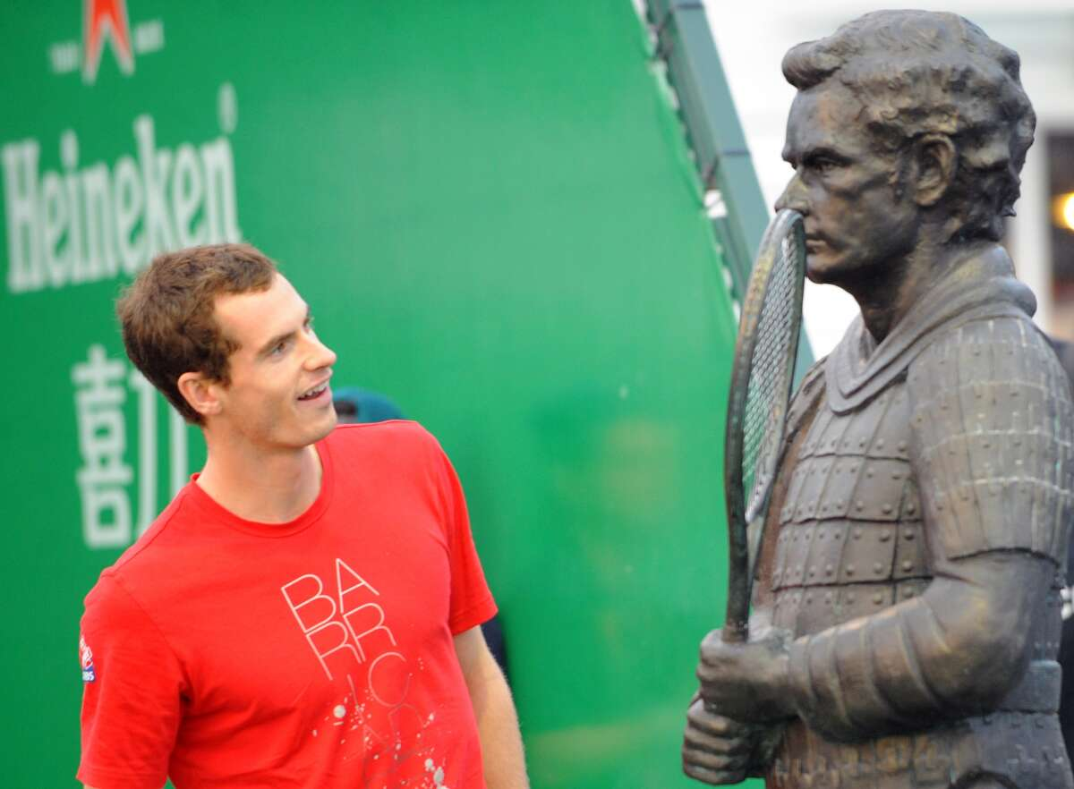 Andy Murray of Britain admires a terracotta statue of himself at the 2011 Shanghai Rolex Masters tournament at the Qizhong Tennis Center in Shanghai on October 11, 2011. Murray last month said that he had held several talks with other players at the US Open on the punishing demands of the tennis schedule and they would be discussing the issue in Shanghai.