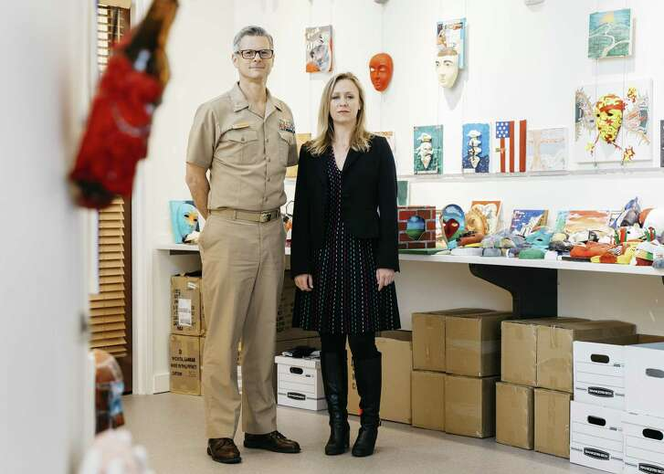 Walter M. Greenhalgh, director of the National Intrepid Center of Excellence, and Melissa Walker, a therapist for the Creative Forces program run by the National Endowment for the Arts, at Walter Reed Military Hospital in Bethesda, Md., March 23, 2017. An art therapy program for military service members helps them cope with haunting memories, disabilities and the future. (Justin T. Gellerson/The New York Times)