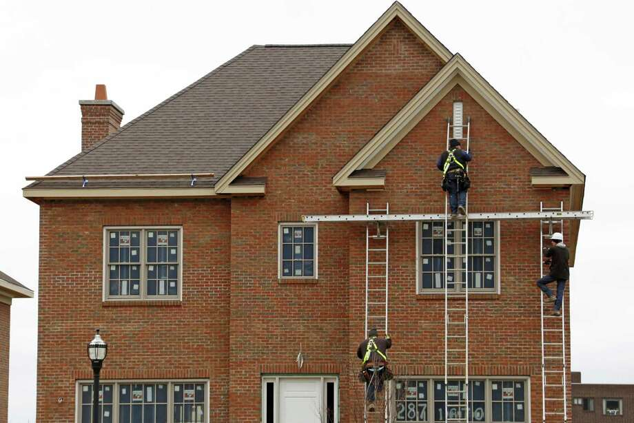 According to the latest data released Thursday by Freddie Mac, the 30-year fixed-rate average slid to 4.14 percent. It was 4.23 percent a week ago and 3.71 percent a year ago. Photo: Gene J. Puskar /Associated Press / Copyright 2017 The Associated Press. All rights reserved.
