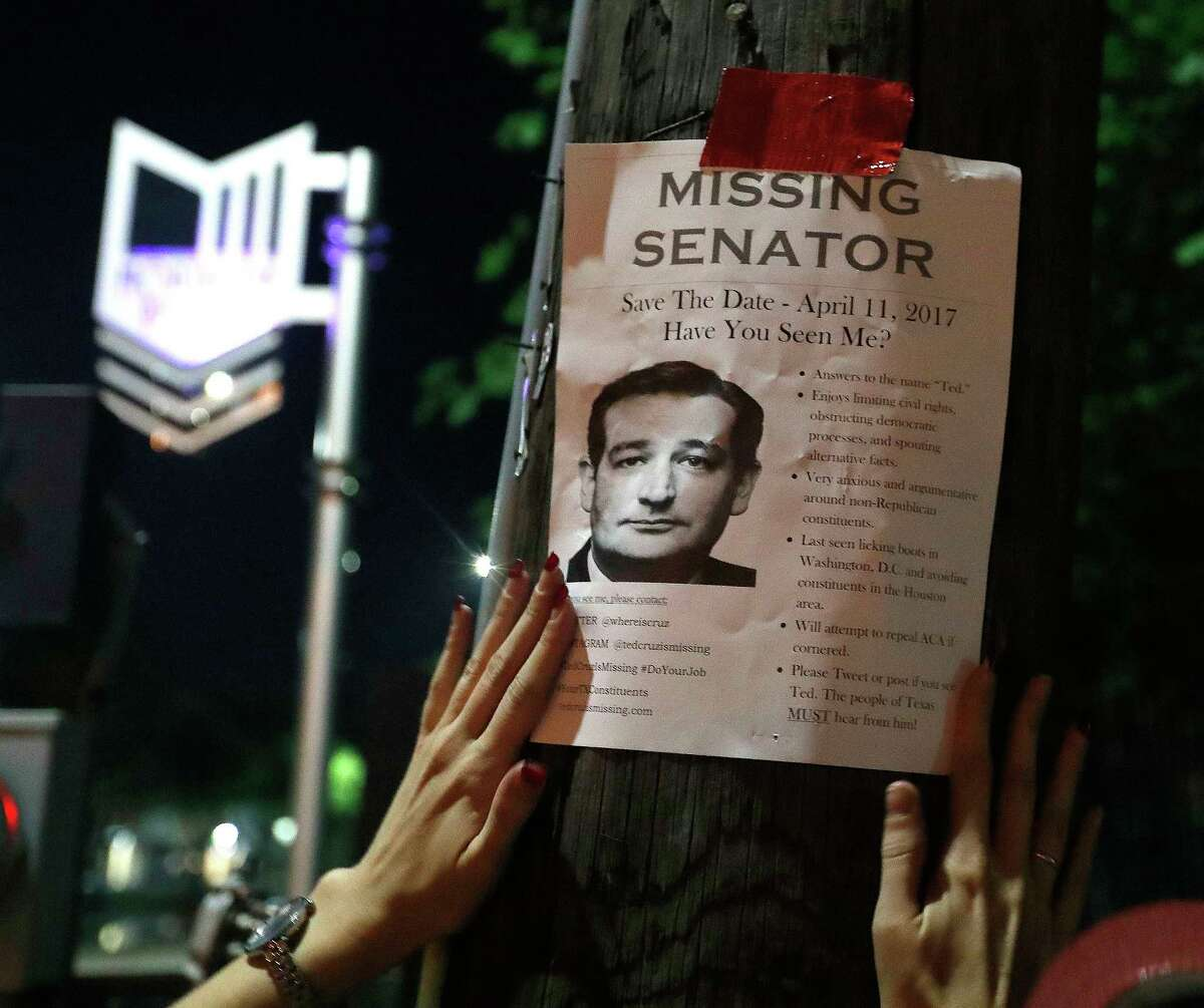 """Using signature red duct tape, Houstonians put up """"Ted Cruz is missing"""" fliers up around a Montrose neighborhood, Wednesday, March 29, 2017, in Houston. The fliers are catching people's attention, ahead of an upcoming """"Ted Cruz Is Missing"""" town hall meeting."""