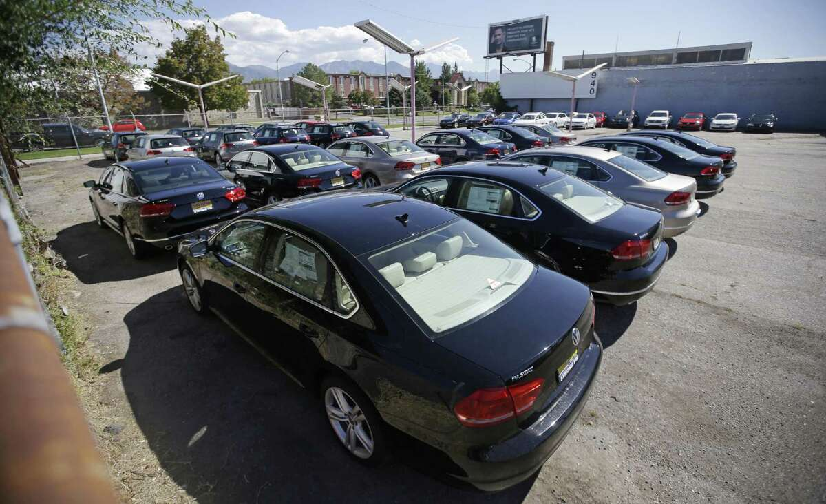 Volkswagen diesel cars are parked in a storage lot near a VW dealership in Salt Lake City in this 2015 photo. Volkswagen received approval from the EPA for its dealers to sell 2015 model-year diesels after updating the vehicles' emissions software, VW Group of America spokeswoman Jeannine Ginivan said. The repair will also include changes to diesel engine hardware, but dealers do not have to wait until the repair parts become available early next year, Ginivan said.