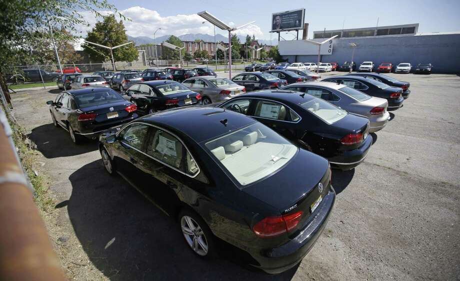 Volkswagen diesel cars are parked in a storage lot near a VW dealership in Salt Lake City in this 2015 photo. Volkswagen received approval from the EPA for its dealers to sell 2015 model-year diesels after updating the vehicles' emissions software, VW Group of America spokeswoman Jeannine Ginivan said. The repair will also include changes to diesel engine hardware, but dealers do not have to wait until the repair parts become available early next year, Ginivan said. Photo: Associated Press /File Photo / AP
