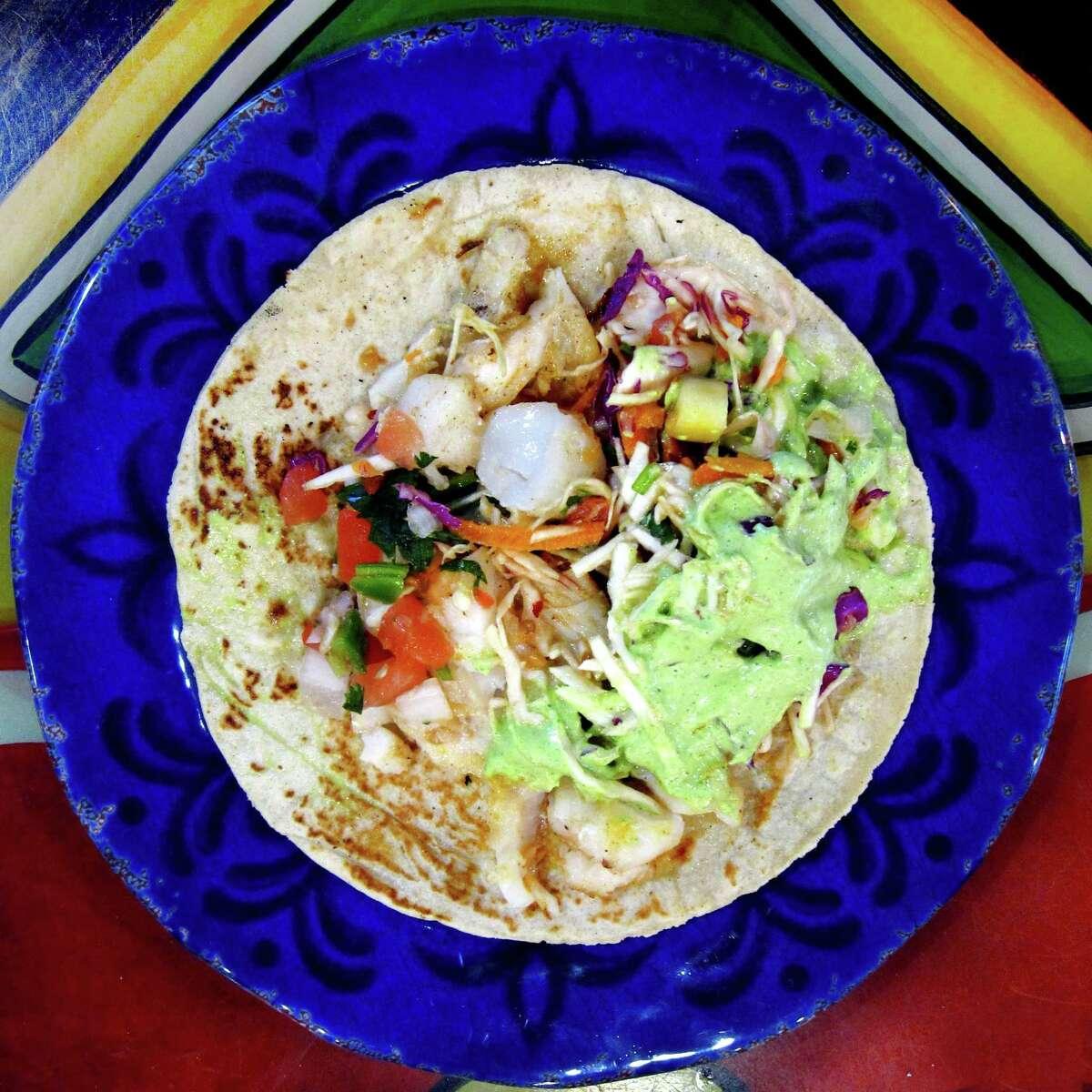 Fish taco on a handmade corn tortilla from Nicha's Comida Mexicana on Roosevelt Avenue.