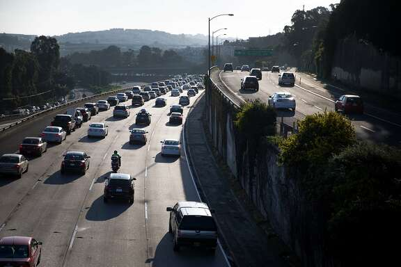 Morning traffic heading towards the Bay Bridge begins to pile at Interstate 101 on Thursday, March 30, 2017 in San Francisco, Calif.