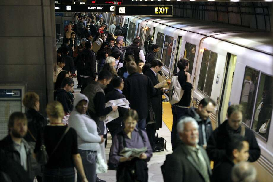 Riders from every walk of life crowd into BART's rail cars, offering an ever-changing tapestry of interactions. Photo: Jessica Olthof, The Chronicle