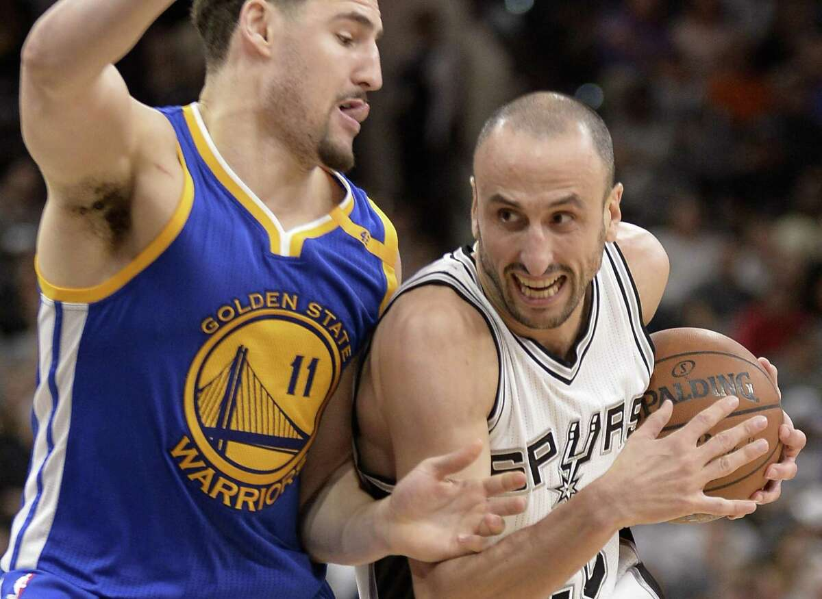Spurs guard Manu Ginobili drives against Golden State Warriors guard Klay Thompson during the second half on March 29, 2017, in San Antonio. Golden State won 110-98.