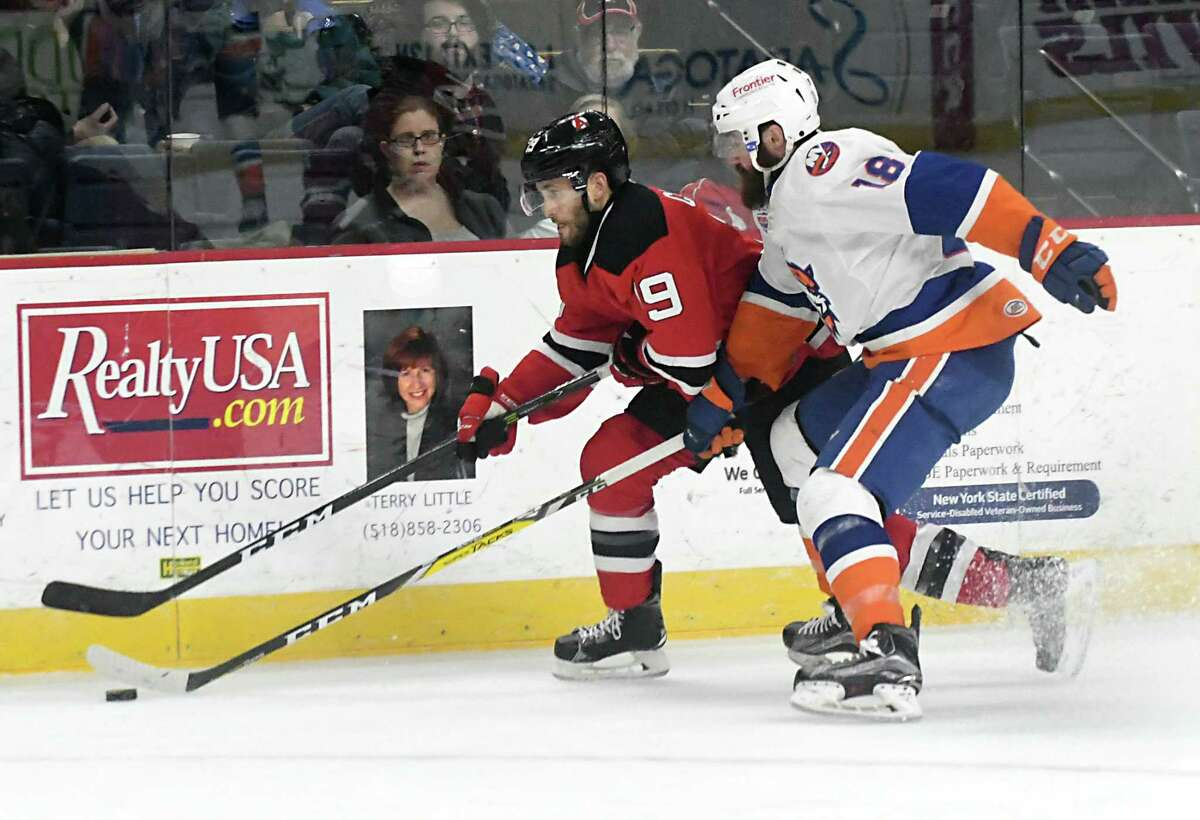 Albany Devils' Carter Camper battles with Bridgeport Sound Tigers' Andrew Rowe for the puck during a hockey game at the Times Union Center on Wednesday, March 22, 2017 in Albany, N.Y. ( Lori Van Buren / Times Union)
