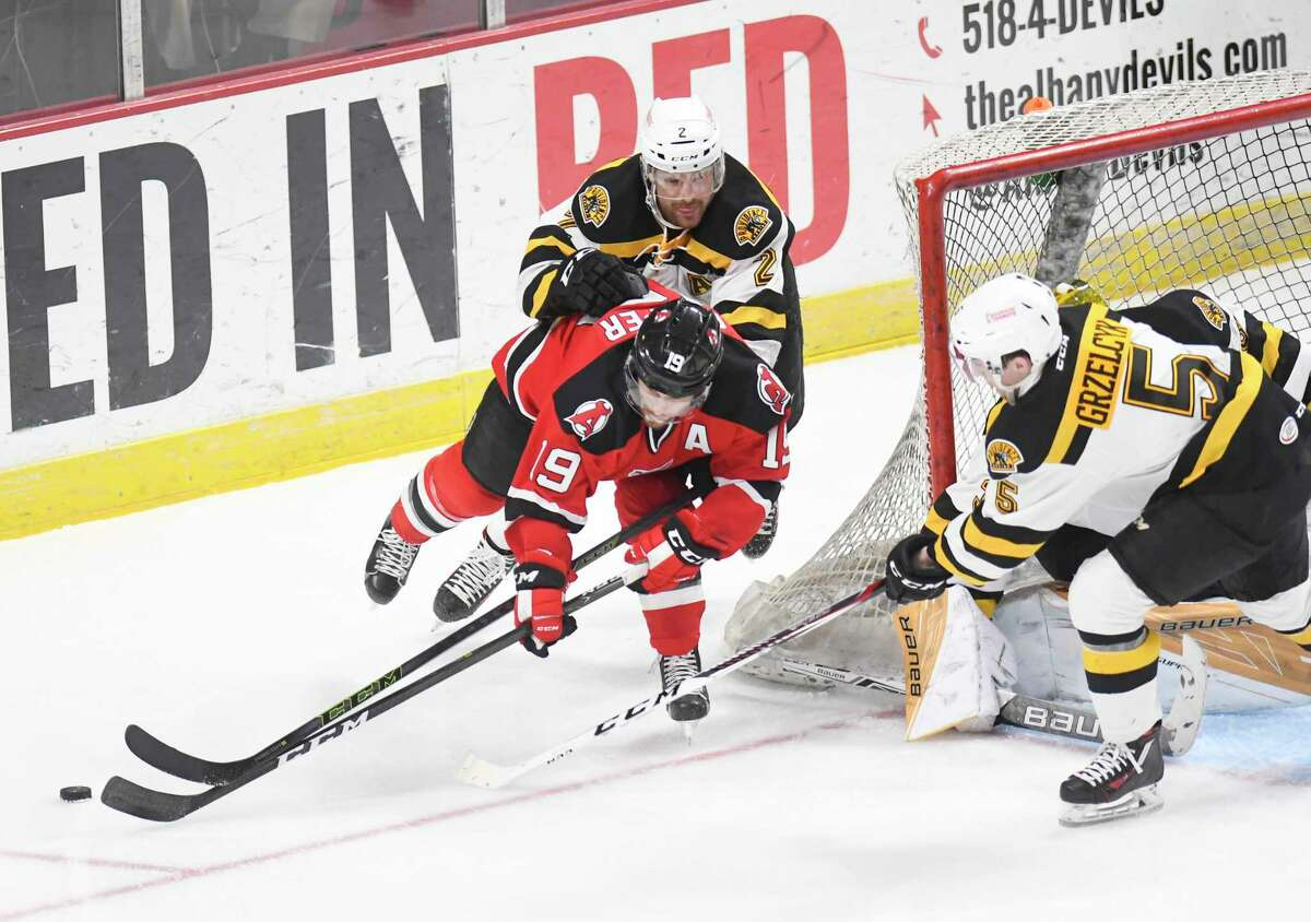 Albany Devils center Carter Camper (19) moves the puck against the Providence Bruins during the second period of an AHL hockey game in Albany, N.Y., Saturday, March 25, 2017. (Hans Pennink / Special to the Times Union) ORG XMIT: HP108