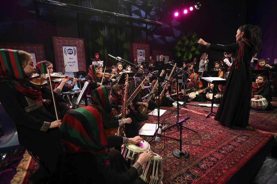 Zarifa Adiba conducts an all-female symphony in Kabul. They hope to change attitudes in a country where many see music as immoral, especially for women. Photo: Rahmat Gul, Associated Press