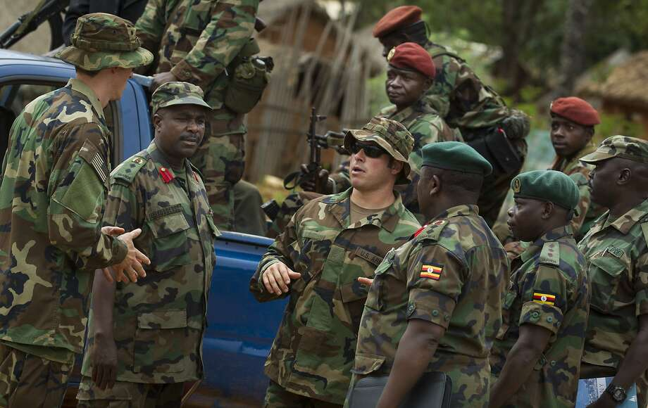 A U.S. Army special forces soldier (center) speaks with African troops in 2012 in Obo, Central African Republic, while searching for rebels of Joseph Kony's Lord's Resistance Army. Photo: Ben Curtis, Associated Press