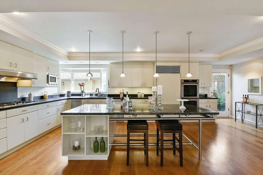 The kitchen of 2341 Leimert Blvd. in Oakland features dual ovens and a quartet of pendant lights. Photo: Open Homes Photography