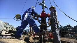 "Oil field workers for Pioneer Natural Resources help frack a well in an oil field south of Midland. Pioneer has added nearly 3 million lateral feet in the Permian by trading acreage with ""all of our friends,"" CEO Tim Dove says."