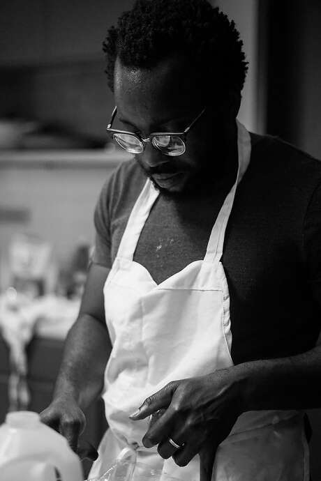 Tunde Wey cooking at a dinner in Austin. Photo: Moyo Oyelola
