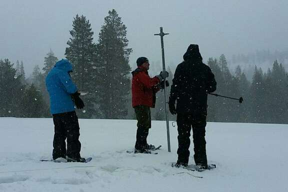 Frank Gehrke, chief of the snow survey program for the state Department of Water Resources, leads a Sierra Nevada snowpack measurement in El Dorado County on March 30, 2017.