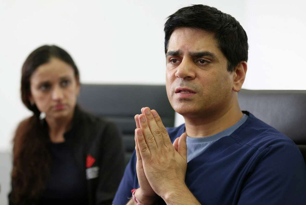 Doctors Pankaj Satija, right, and his wife Monika Ummat, left, talk to media about their immigration case at the Quan Law Group Thursday, March 30, 2017, in Houston. Satijaand Ummat are facing possible immediate return to India.