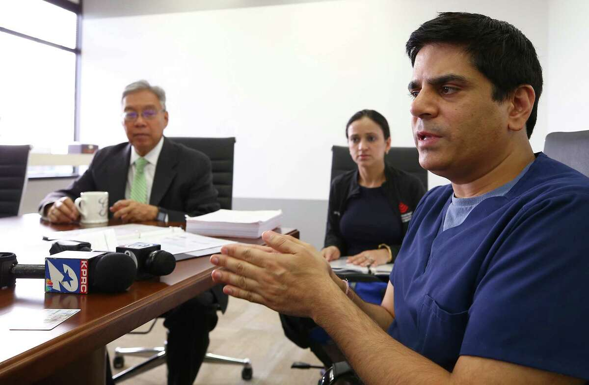 Doctors Pankaj Satija, right, and his wife Monika Ummat, center, talk to media about their immigration case at the Quan Law Group Thursday, March 30, 2017, in Houston. Satija and Ummat are facing possible immediate return to India.