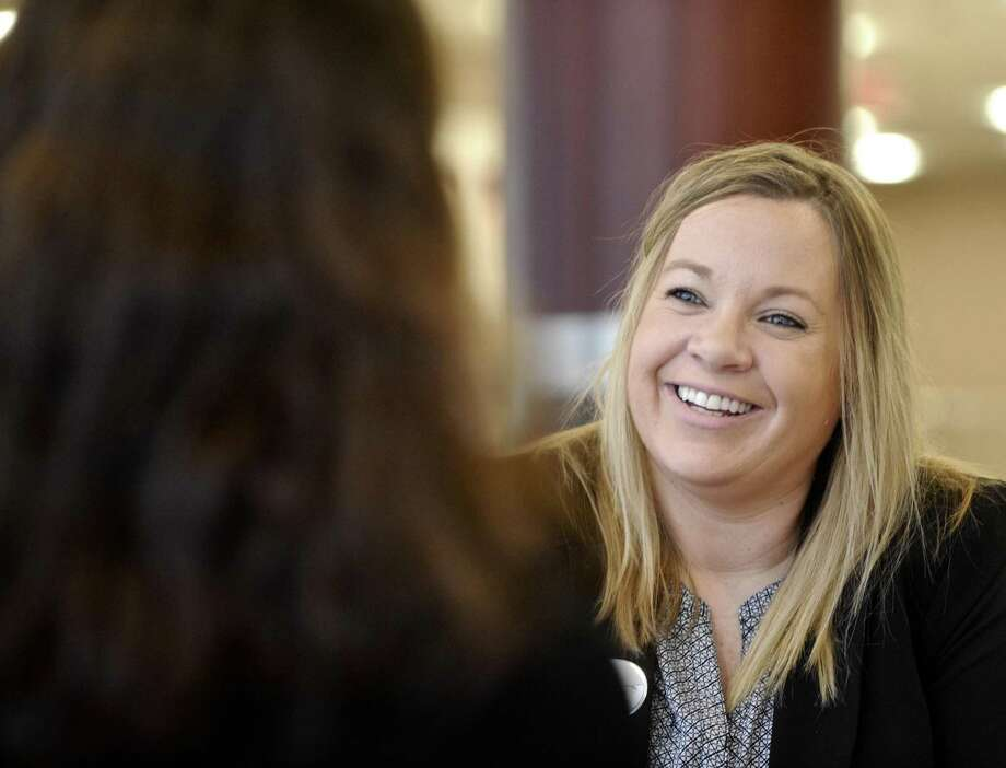 Devon Scanlion, right, owner of Chick-fil-a, in Brookfield, talks with Bethel High School business teacher Monica Black during Junior Achievement career day, held at the Matrix Center, in Danbury, Conn, on Thursday,March 30, 2017. Photo: H John Voorhees III / Hearst Connecticut Media / The News-Times