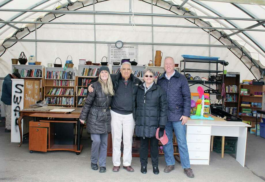 Swap Shop volunteers Kathy Dobbins, Dan Dolcetti, Sue Cameron and Reese Hutchison at the Swap Shop in Darien on March 24. Photo: Erin Kayata / Hearst Connecticut Media / Darien News