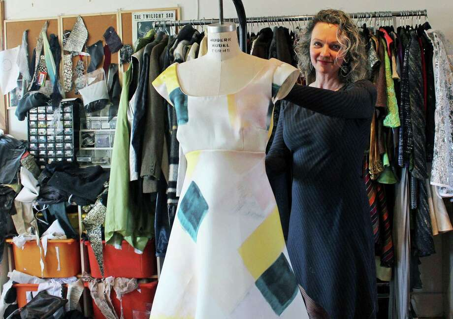 """Designer Jennifer Butler makes some adjustments to one of her 60s-inspired dresses that will be part of a """"Fashionable Fairfield"""" show and luncheon in conjunction with """"Talkin' Bout My Generation: Fairfield in the 19603 & 1970s,"""" a new exhibit at the Fairfield Museum and History Center. Fairfield,CT. 3/29/17 Photo: Genevieve Reilly / Hearst Connecticut Media / Fairfield Citizen"""