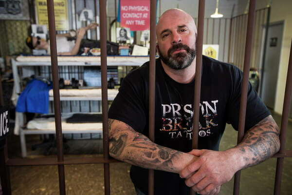 Bryan BK Klevens, a Houston Police narcotics sergeant and owner of Prison Break Tattoos, poses for a portrait on Wednesday, March 29, 2017, in Houston. Houston Police Chief Art Acevedo plans to roll out a new policy, allowing officers to be allowed to expose their tattoos, which previously they had to cover, by summer.