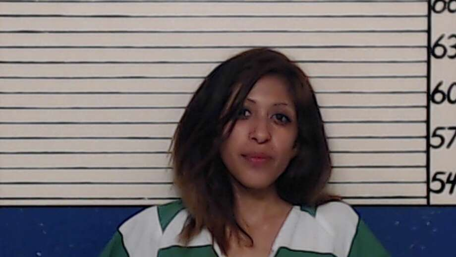 Mayra Salinas, 26, faces a charge of fraudulent use of between 10 and 50 items identifying information, a second-degree felony, and a charge of marijuana possession.  She remains in the Comal County Jail on a $10,750 bond. Photo: Comal County Jail