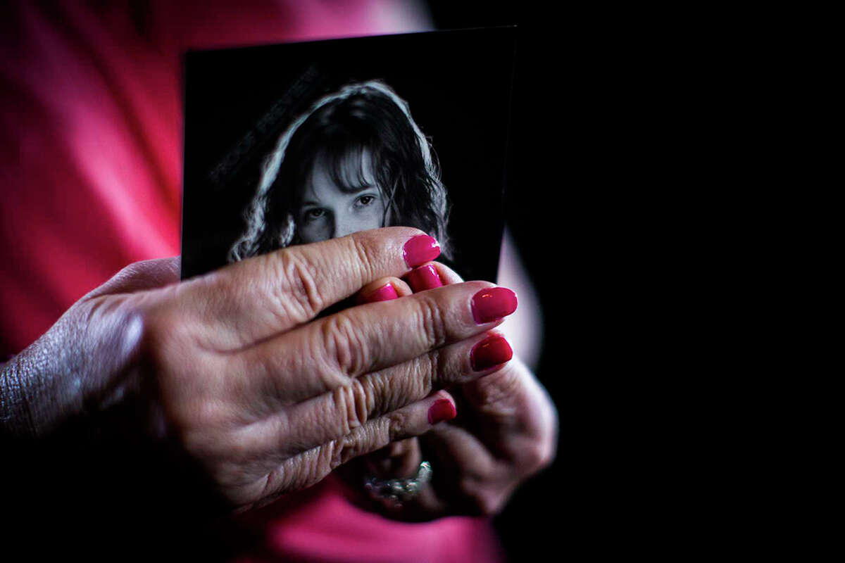 The mother of a rape victim holds a photograph of her child, Wednesday, March 22, 2017, at her home in Cypress.