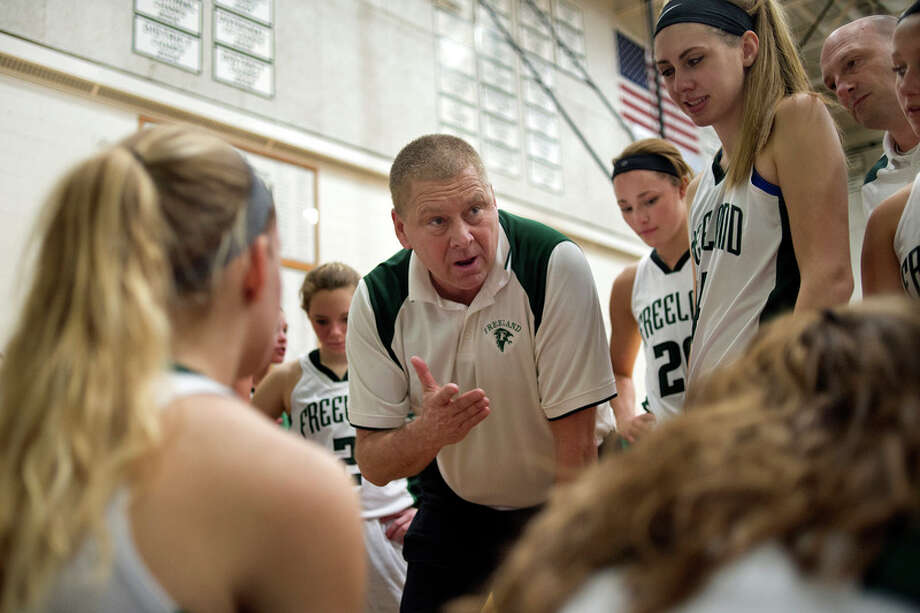 BRITTNEY LOHMILLER | blohmiller@mdn.net Freeland coach Tom Zolinski talks to his team in-between quarters in the first half of the Friday evening game against Bullock Creek. Freeland defeated Bullock Creek 68-25 and remain undefeated.
