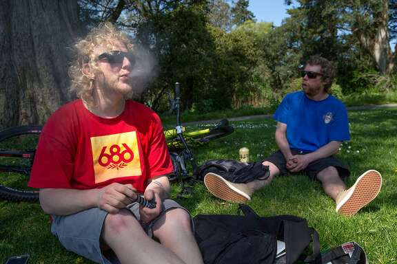 From left: Justin P. and Kevin R. smoke week at Hippie Hill on Thursday, March 30, 2017, in San Francisco, Calif. The two friends are visiting from South Lake Tahoe. They said they're making their way down to the Santa Cruz mountains for a bike ride and said they might come back to San Francisco for 4/20.