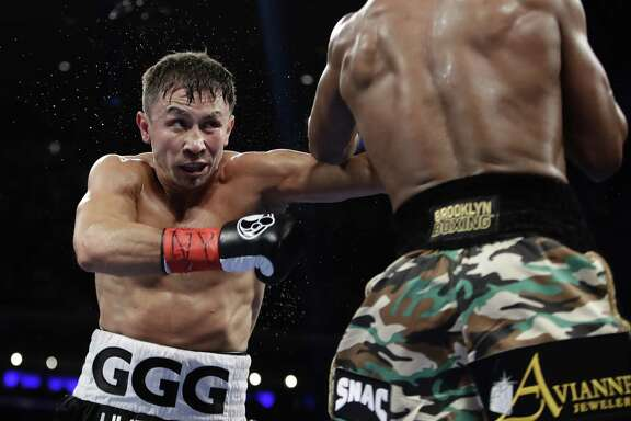 Gennady Golovkin of Kazakhstan fights Daniel Jacobs during the third round of a middleweight boxing match on March 19, 2017, in New York.