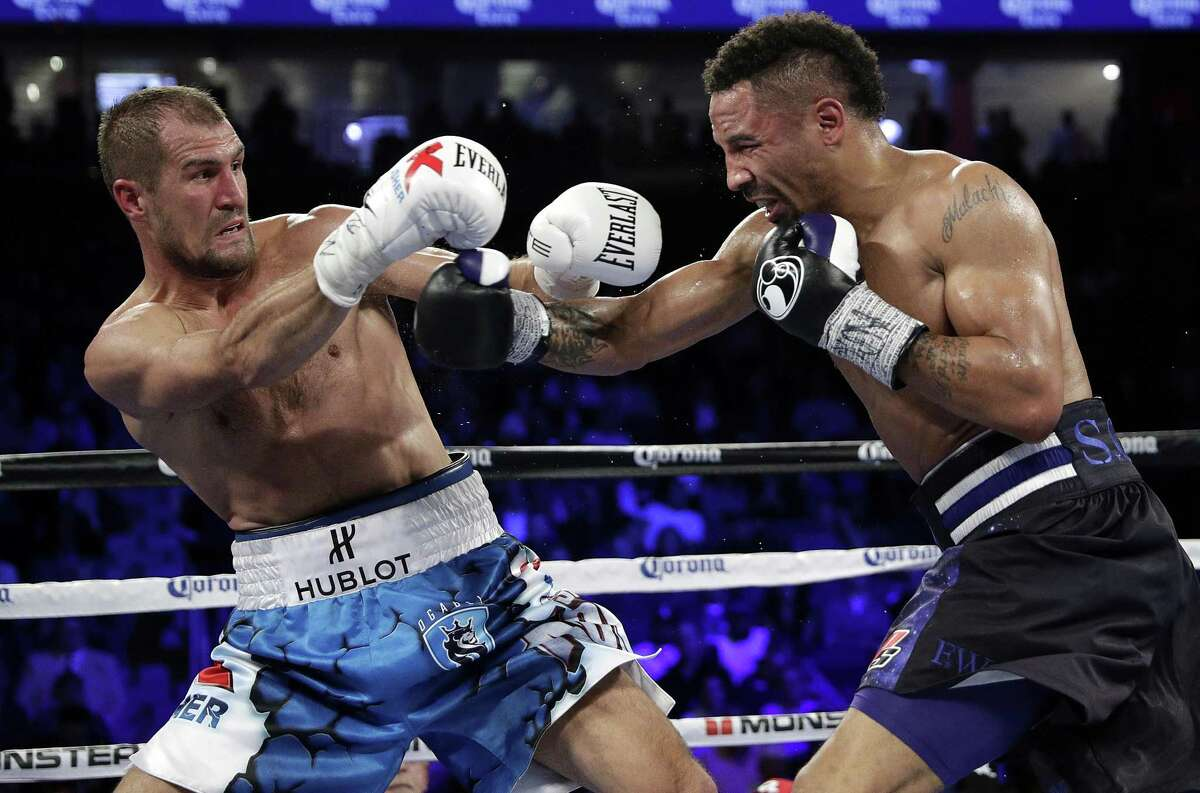 Sergey Kovalev (left) of Russia backs away from a punch from Andre Ward during a light heavyweight boxing match, on Nov. 19, 2016, in Las Vegas.