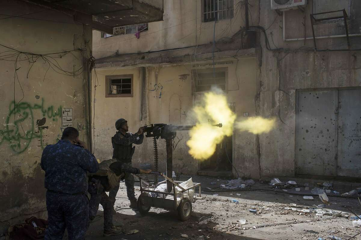 March 30, 2017 Federal policemen fire towards Islamic State positions in the old city during fighting on the western side of Mosul, Iraq. The government of Iraq is attempting to push the Islamic State out of Mosul and Iraq.