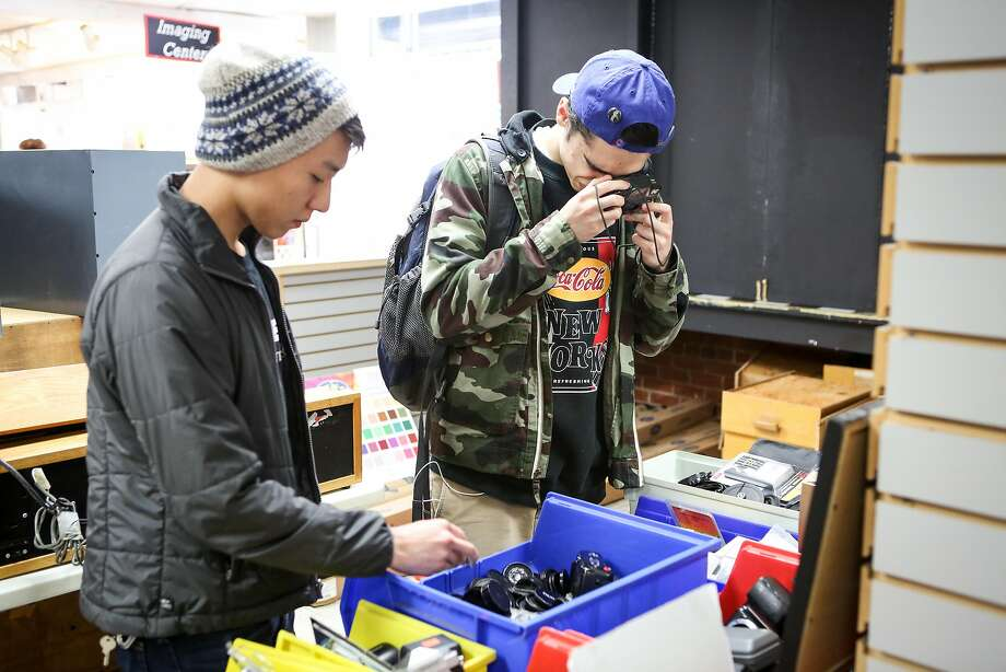 Henry Tran (left) and Dominc Bravo look to buy equipment at discounted prices at Adolph Gasser the day before the closing of on Thursday, March 30, 2017 in San Francisco, Calif. Photo: Amy Osborne, Special To The Chronicle