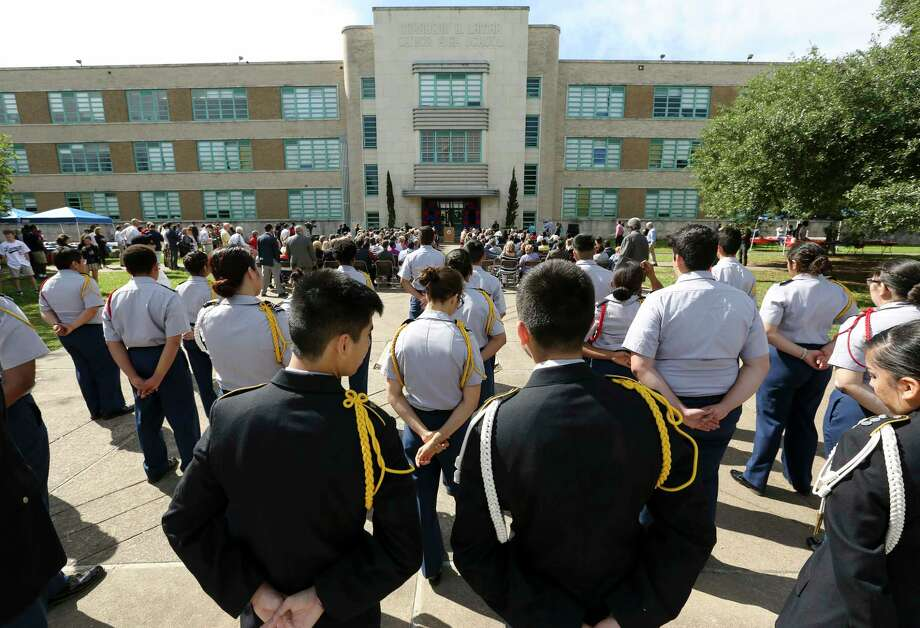 Two JROTC members share a moment during the Lamar High School groundbreaking ceremony for the new school building Thursday, March 30, 2017, in Houston. Lamar High School invited alumni from its past 80 classes to participate the ceremony. ( Yi-Chin Lee / Houston Chronicle ) Photo: Yi-Chin Lee, Staff / © 2017  Houston Chronicle