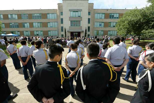 Two JROTC members share a moment during the Lamar High School groundbreaking ceremony for the new school building Thursday, March 30, 2017, in Houston. Lamar High School invited alumni from its past 80 classes to participate the ceremony. ( Yi-Chin Lee / Houston Chronicle )