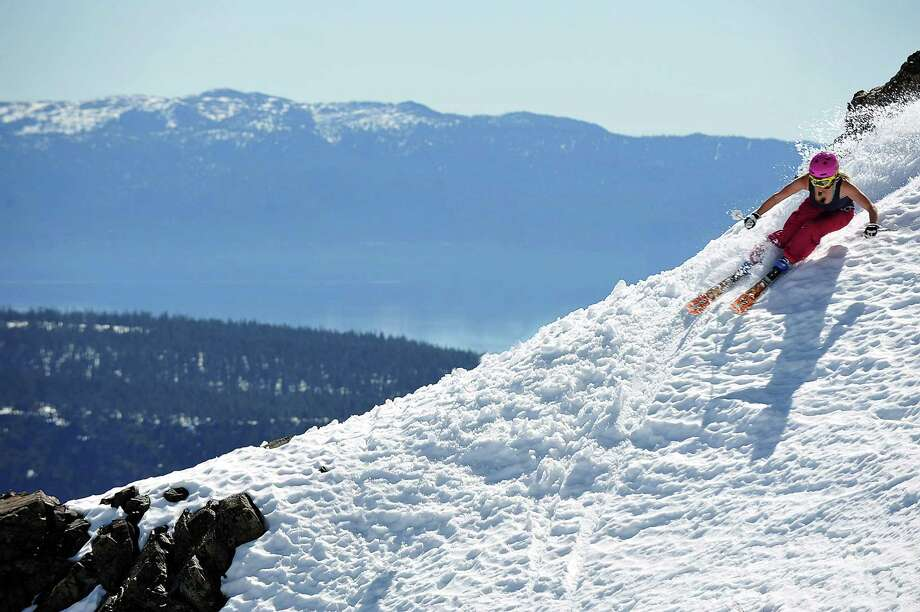 In spring the peak slope hours tend to be between 10 a.m. and 2 p.m., which as temps start to climb in the Sierra, means many people opt for tank tops and t-shirts. Photo: Squaw Valley Alpine Meadows