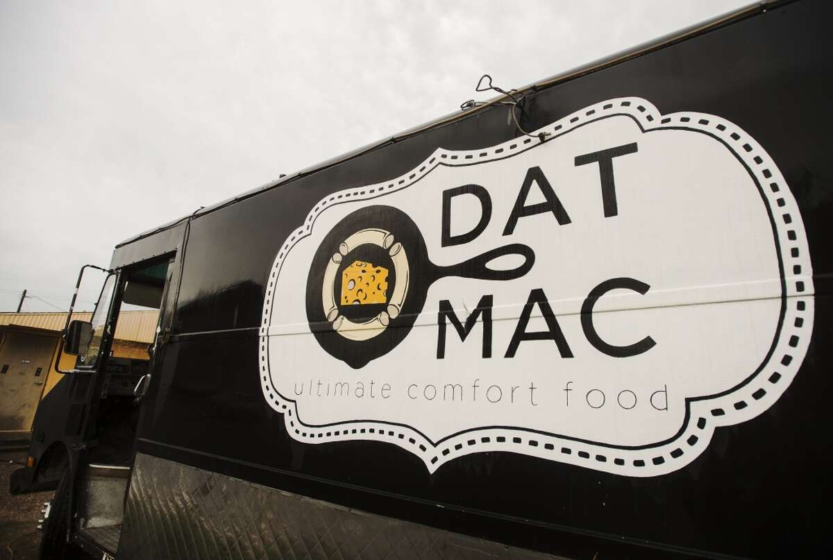 The Dat Mac truck sits outside the Texas Rose Saloon on Tuesday evening. The mobile restauranteurs behind the Dat Mac food truck serve up gourmet macaroni and cheese dishes. Photo taken Tuesday 6/30/15 Jake Daniels/The Enterprise