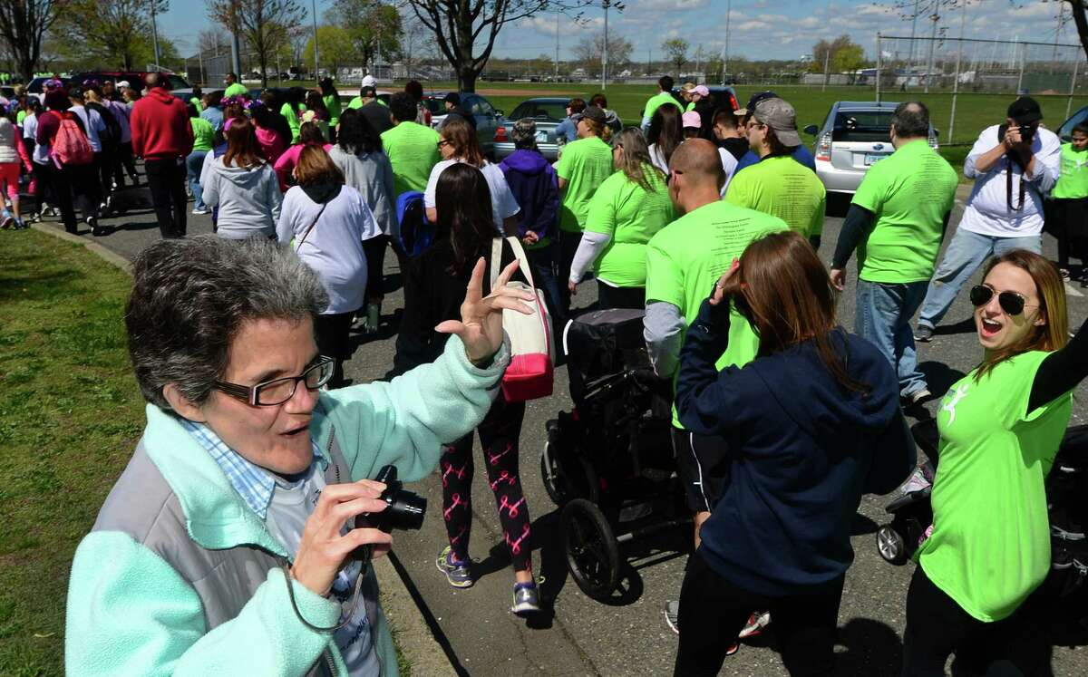Cancer survivor Anna Nastrolillo greets participants in The 2016 Whittingham Cancer Center Walk & Sally's Run Saturday April 30, 2016 at Calf Pasture Beach in Norwalk, Conn. Thousands of supporters turned out for Norwalk Hospital's cancer center walk/run event, now in its 13th year.