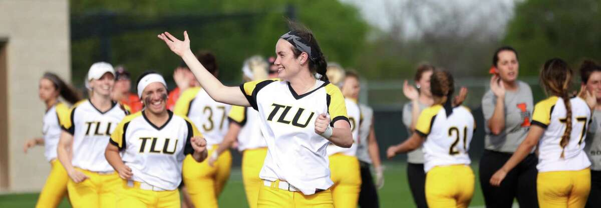 Texas Lutheran softball pitcher Maitlin Raycroft (center, arm raised) has produced six no-hitters this season, setting a Division III record.