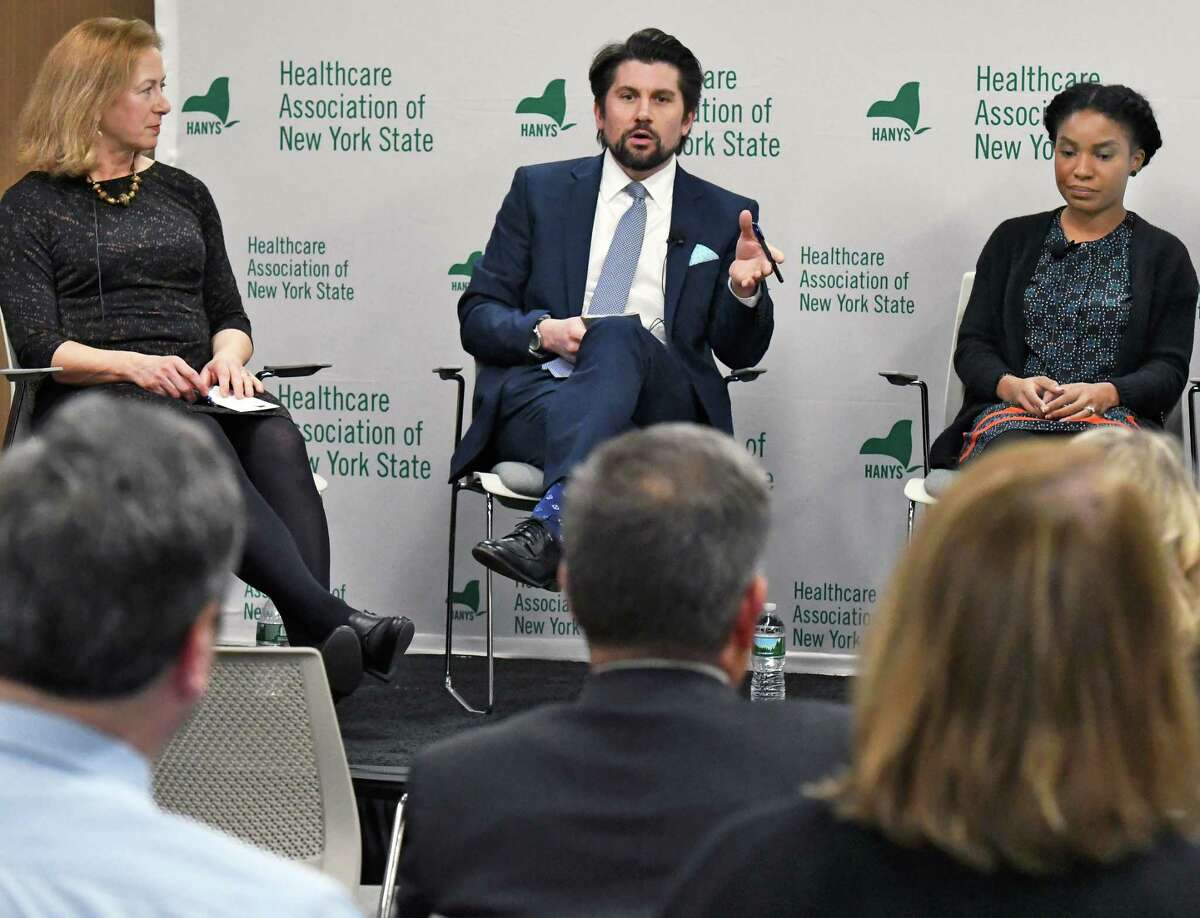 HANYS president Bea Grause, left, Rockefeller Institute president Jim Malatras, and NYS policy director for Medicare rights center Kystal Scott, right, take part in a Healthcare Association of New York State panel discussion to offer insight into the next steps for the Affordable Care Act on Thursday, March 30, 2017, in Rensselaer, N.Y. (John Carl D'Annibale / Times Union)