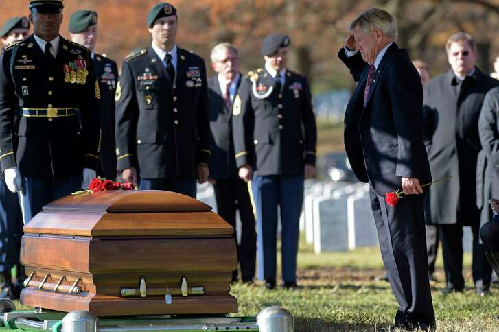 James Moriarty salutes the casket of his son, U.S. Army Staff Sgt. James F. Moriarty, at Arlington National Cemetery.