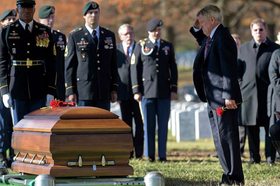 James Moriarty salutes the casket of his son, U.S. Army Staff Sgt. James F. Moriarty, at Arlington National Cemetery. Photo: Susan Walsh, STF / Copyright 2016 The Associated Press. All rights reserved.