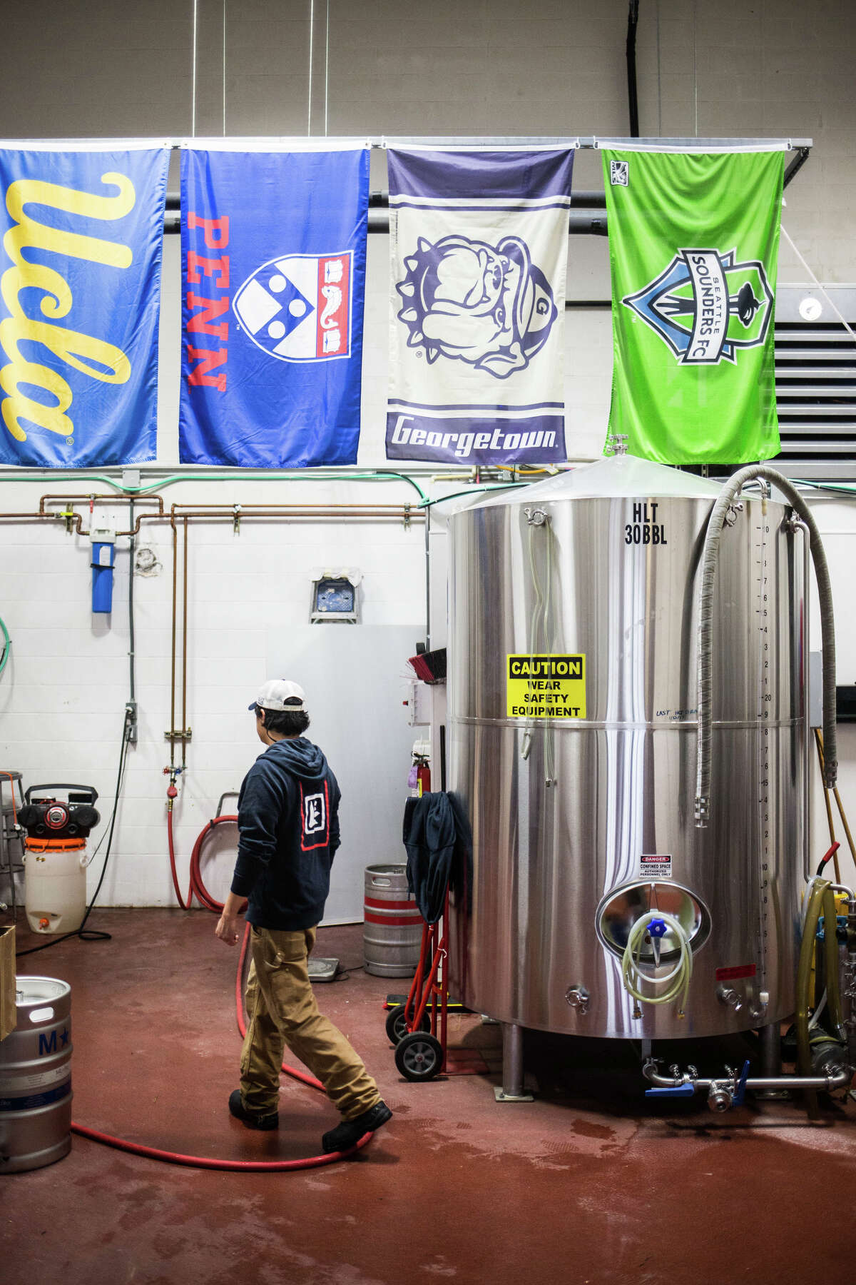 Brewmaster Barry Chan walks through his brew house at Lucky Envelope Brewing in Ballard on Tuesday, March 28, 2017. (GRANT HINDSLEY, seattlepi.com)